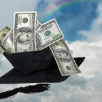 money in a graduation hat